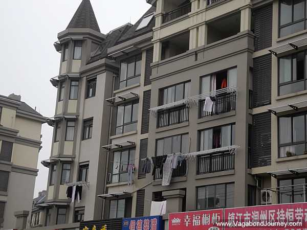 Laundry hanging outside windows show that people live inside