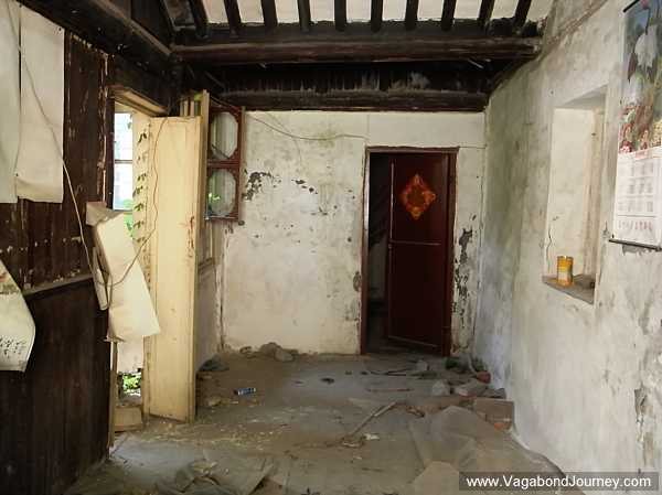 Inside of a traditional home that has been abandoned