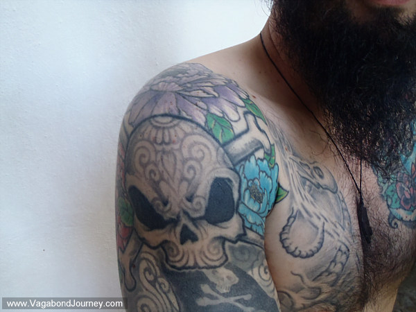 skull tattoos arm. Skull Tattoo Video half sleeve