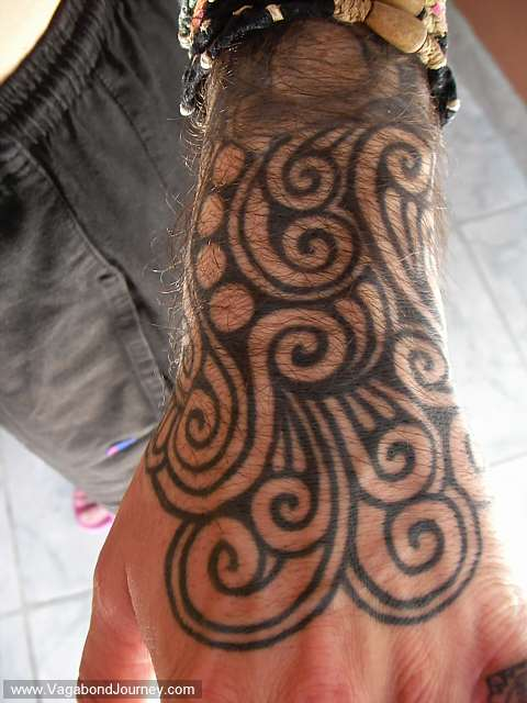 Hand tattoo done in Bangkok Thailand by Mr. Tung in the Khao San Road
