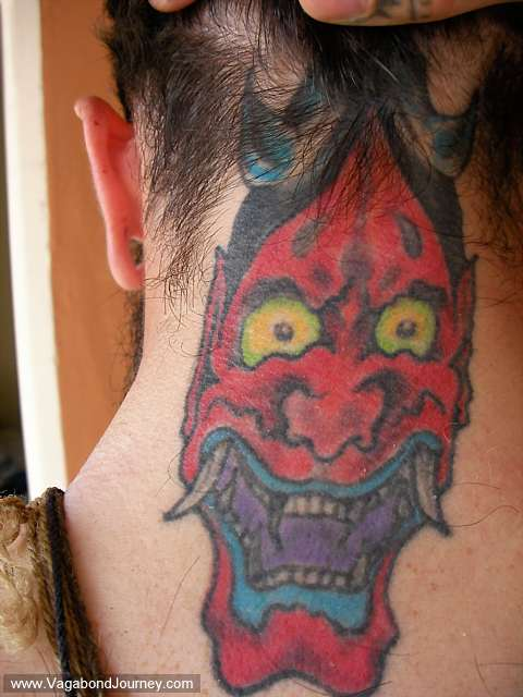 Japanese style neck tattoo of an Aka Oni from Japanese literature and