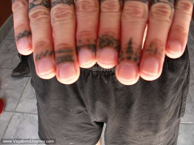 "My finger tattoos were done by a train hopping hobo named ""Earl"" who had his"