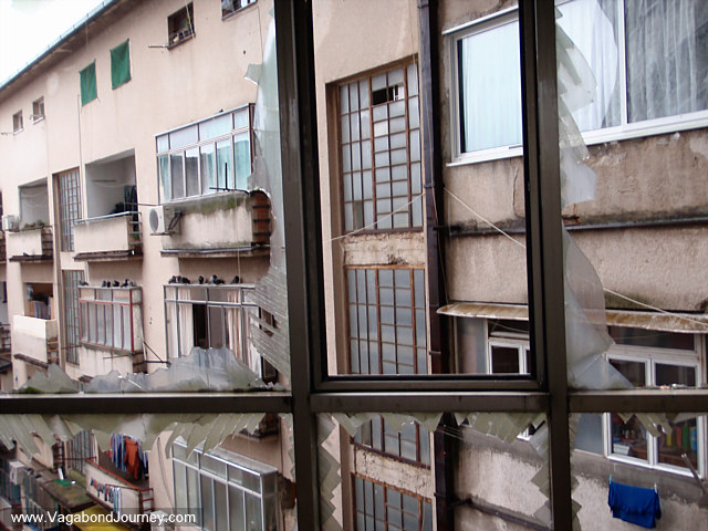 View from broken windows in bombed out high rise Mostar, Bosnia