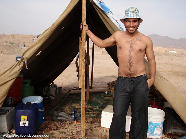 photo of man with tent on beach in Aqaba Jordan