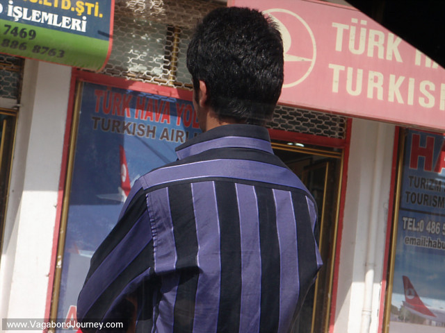 photo of Turkish man in front of Turkish Airways travel agency
