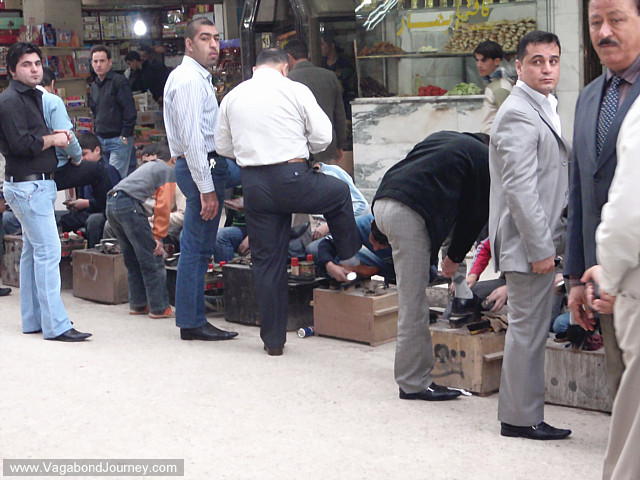 photo of a line of men getting their shoes shined in dohuk, iraq