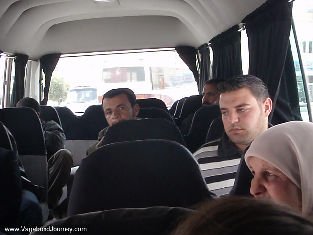 men and women in a minibus taxi in jordan