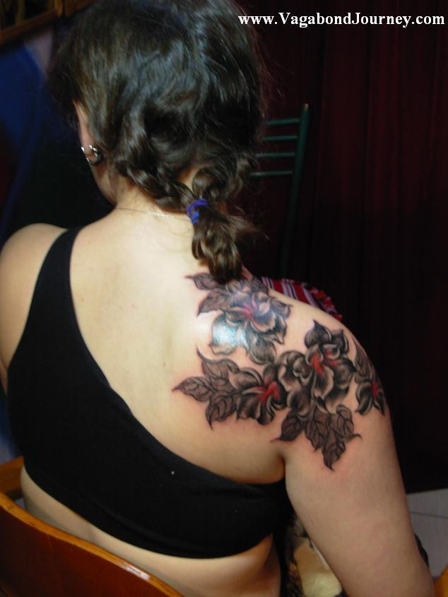 The above tattoo is of peony flowers that were done by the tattoo artist,