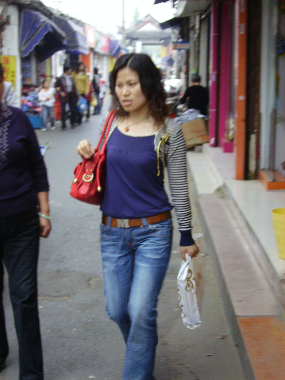 Chinese girl walking down the street while shopping shaoxing china