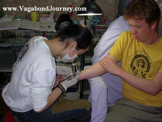 Dave Getting A Traditional Tibetan Design Of Flaming Sword Tattoo