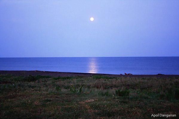 Full moon setting at Palaui Island