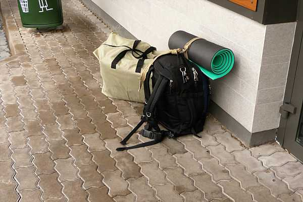 Inflatable kayak in bag next to my 45L backpack