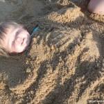 Baby Buried Sand