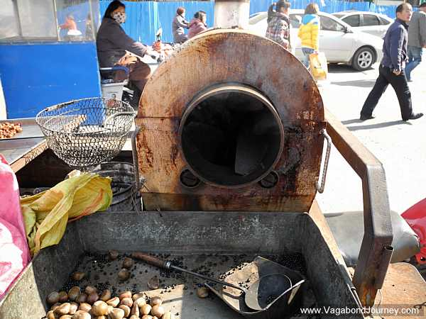 The chestnuts are loaded into this cooker and are spun and heated