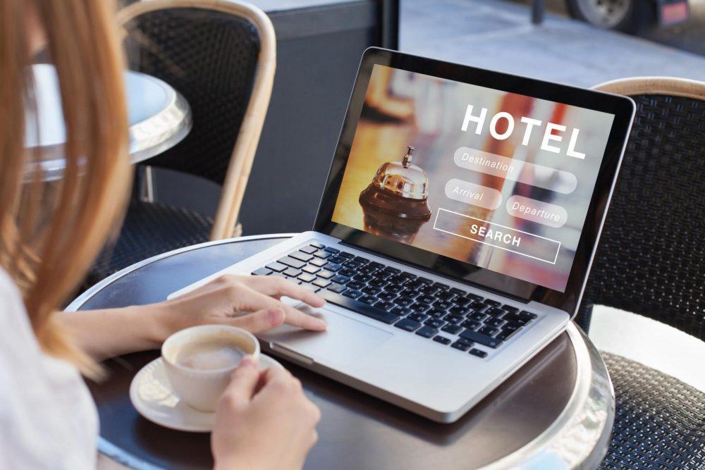 Digital nomad on computer at cafe
