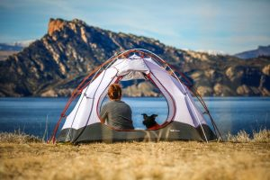 Camping in a tent on a lake