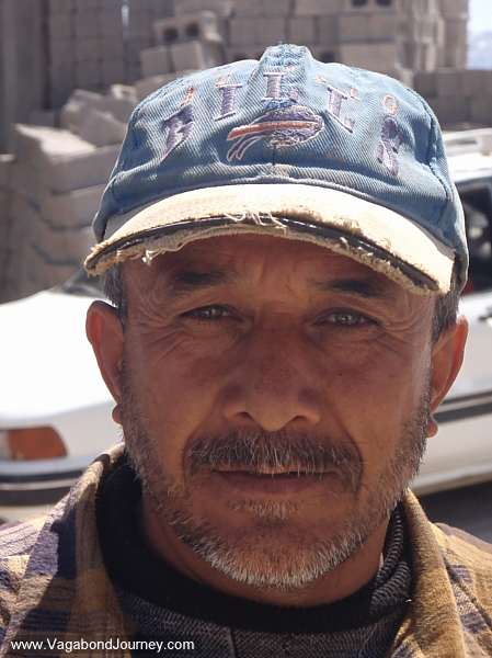 Kurdish man in Iraq with a Buffalo Bills hat on
