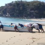 Men Push Boat
