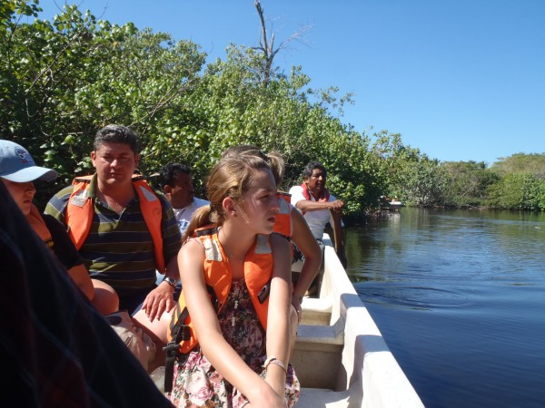 Tourists on boat in Ventanilla