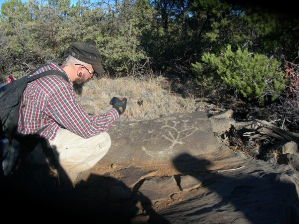 Wade inspecting a petroglyph in the Tonto Forest of Arizona